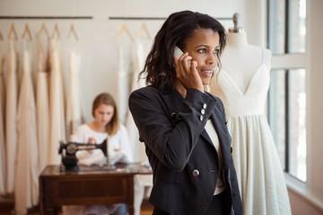 Fashion designer taking on mobile phone