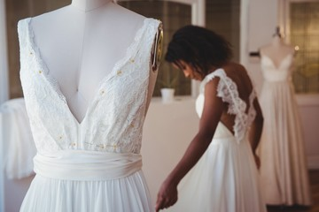 Close-up of wedding dress on mannequin