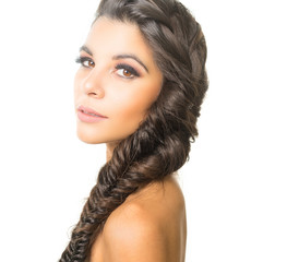 Beautiful exotic young woman with braided hair