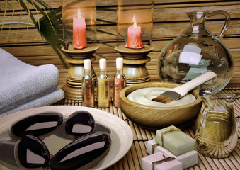 The still life Spa with aromatic oil, candles, a lotus flower