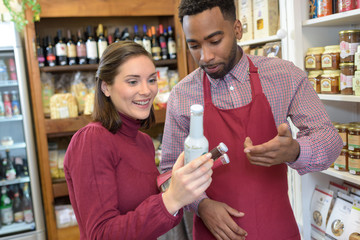 Shopkeeper advising customer