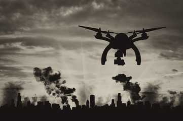 Silhouette flying reconnaissance drone over the city in smoke
