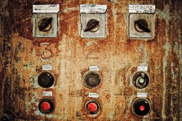 Closeup of old rusty control panel