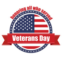 Rubber stamp with red ribbon with the text Veterans Day