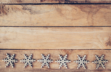 Christmas decoration with wood snowflake on table with copy spac