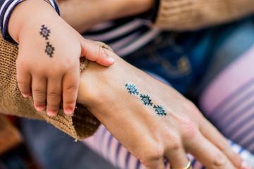Mother and daughter fake tatoos