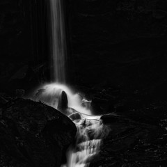 Beautiful waterfall in forest landscape long exposure flowing th