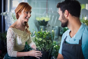 Couple arranging flower bouquet