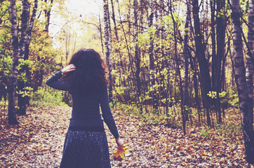 Stylish girl in fall forest