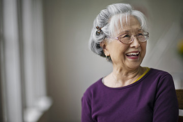 Portrait of a smiling senior woman at a doctor's office.