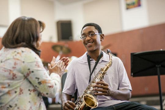 Teacher instructing student in music class