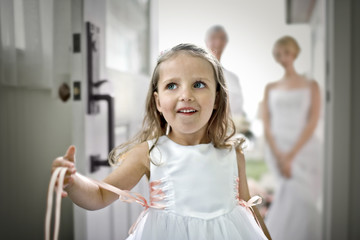 Young girl dressed as a flower girl.