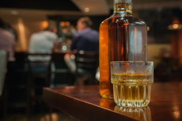 Glass of Bourbon at at a Bar