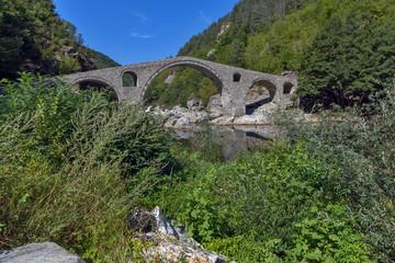 Reflection of Devil's Bridge and Rhodopes mountain in Arda river, Kardzhali Region, Bulgaria