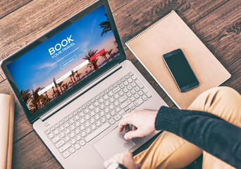 Man using a modern laptop for booking hotel online. Tour reservation