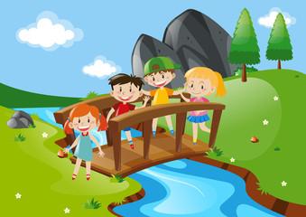 Four kids crossing bridge