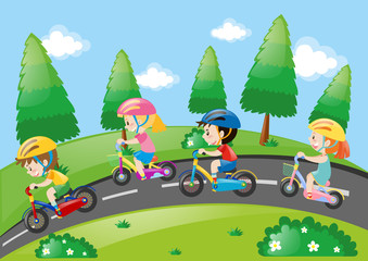 Children riding bicycle in the park