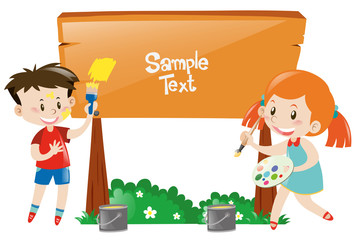 Boy and girl painting wooden sign