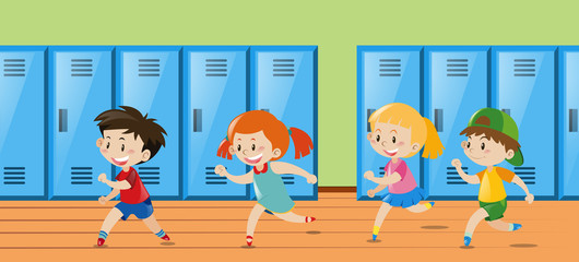 Four kids running in locker room