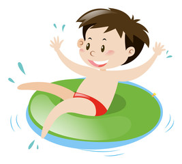 Little boy on green floating ring