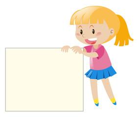 Happy girl holding white paper