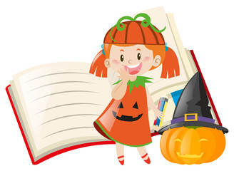 Girl in halloween costume and empty book