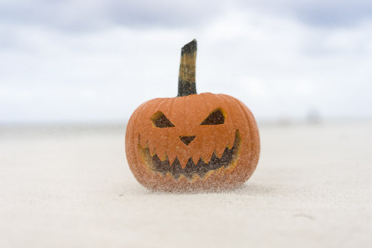 Evil Halloween pumpkin on beach