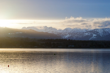 View of Comox Valley glacier at sunset from Comox harbour
