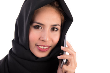 young muslim woman with smartphone isolated on white background