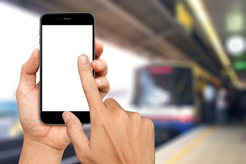 Hand are holding and touch Smartphone with sky train background
