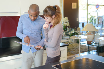Couple in kitchen showroom
