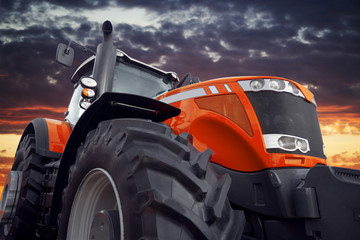 Wall Mural - Farm tractor working at sunset
