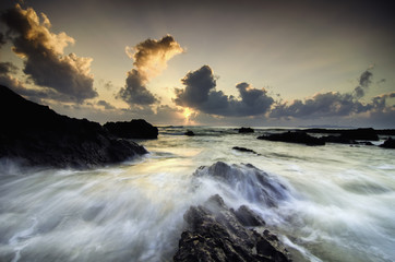 blurred image background. the beauty scenery of terengganu beach with stunning color during sunrise with dramatic clouds