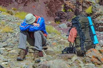 Trekker resting in height mountain Wall mural
