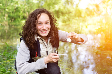 Young attractive biologist woman working on water analysis