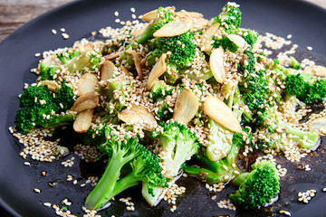 Steamed broccoli with garlic chips and sesame seeds