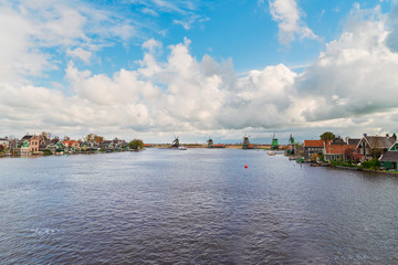traditional Dutch windmills of Zaanse Schans over river at summer day, Netherlands,