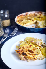 Potatoes roasted with cream in ceramic blue dish