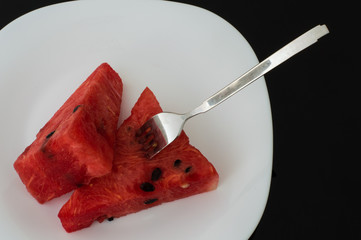 Fresh Watermelon Served in a White Plate on a Table