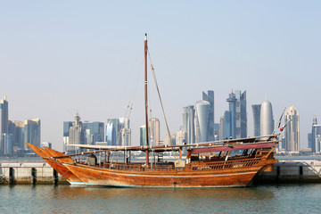 Dhow with skyline of Doha in the background, Katar
