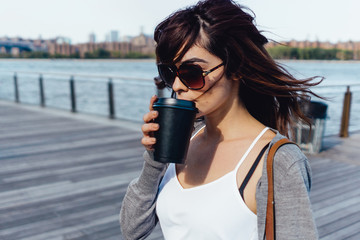 Young Beautiful Woman Walking in Brooklyn With a Coffee to Go . New York City US