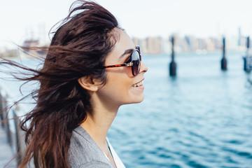 Young Beautiful Woman Portrait With Manhattan Skyline in the Background  . New York City US