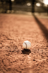Sepia baseball on diamond