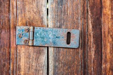 Hinge Lock on old wooden door.