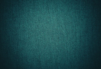Dark turquoise woolen sweater background