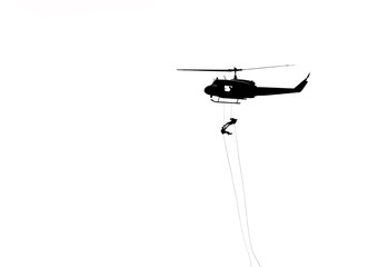 silhouette soldiers in action rappelling climb down from helicopter with military mission counter terrorism assault training isolated on white background.