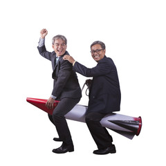 portrait of senior asian business man playing riding on rocket h