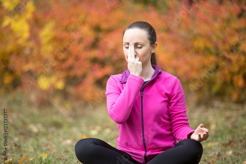 Portrait of sporty beautiful young woman practicing yoga