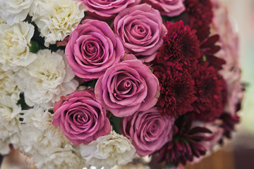 Pink and white flowers in the wedding bouquet