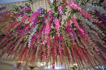 Unusual flowers are hanging on the wedding tent